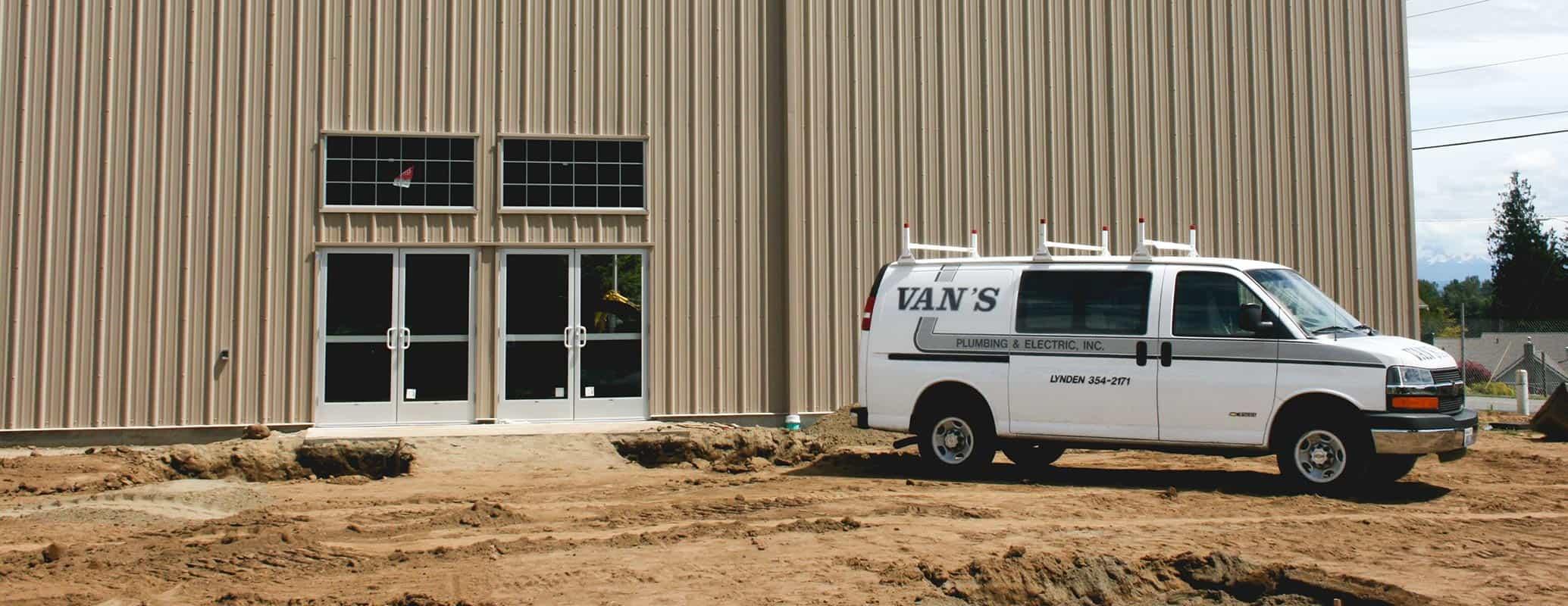 Van's Plumbing & Electric Van on Commercial Job Site